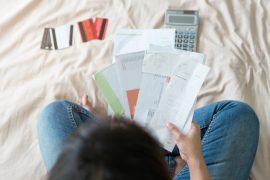 woman looking over financial documents